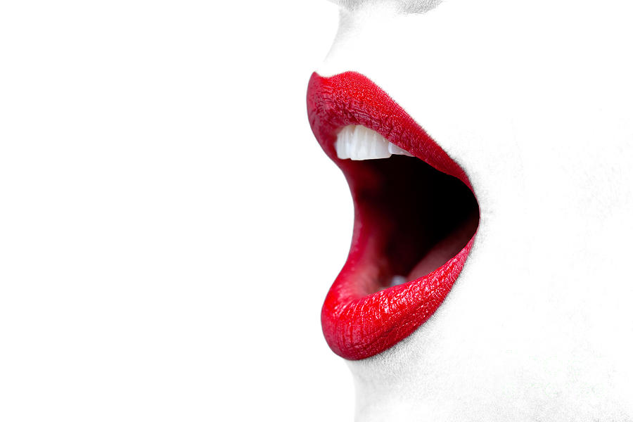 womans-mouth-wide-open-with-red-lipstick-richard-thomas